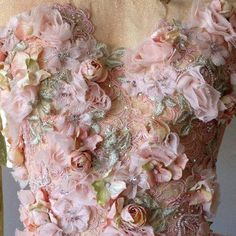 floral embellishment...OMG, beautiful. Imagine this in your wedding colors. Ask your dressmaker for suggestions.