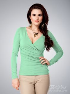 Ruched front top in mint: This beautiful top will flatter your figure with its ruched front and wrap design. The material will hide any problem areas while the V-neck will boost your best assets.