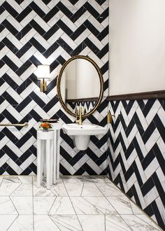 black and white chevron tile design / powder room // via @formlosangeles