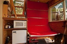Genius Backyard Micro Guesthouse in Seattle with Living Roof - bed rolled up to stow away