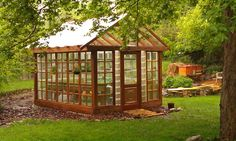 this greenhouse was made by one of our ReStore customers, but I think it looks like something from a fairy tale forest... They started with 16 windows, an old door, and some reused louvred windows.