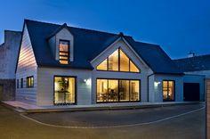 Honka Blockhaus Modell Esquibien Aussenansicht bei Nacht