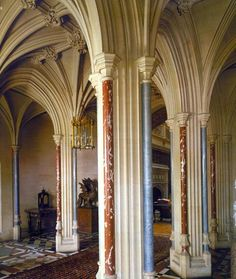Highclere Castle, West Berkshire, England. The Entrance Hall features coloured marble columns and a ribbed vaulted ceiling