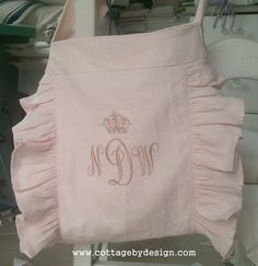 Three letter swirly monogram with petite crown on top, messenger bag with ruffles in pale pink linen
