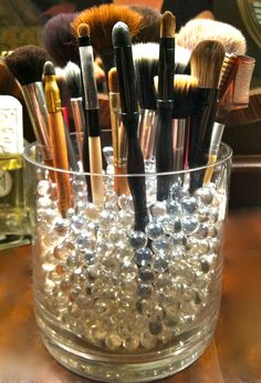 Organization for make up brushes, Large vase, filled with clear glass marbles to keep the brushes standing, good idea!