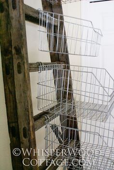 Thursday, January 2011 Vertical Storage with Vintage Wire Baskets & an Antique Ladder - Really unique and fun craft organization inspiration. Antique Ladder, Old Ladder, Vintage Ladder, Leaning Ladder, Vintage Decor, Vintage Wire Baskets, Metal Baskets, Storage Baskets, Storage Racks