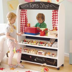 Fun pretend play zone - shop, cafe, puppet show