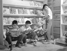 Japanese-American boys reading comic books in Tule Lake Relocation Center, Newell, California, United States, 1 Jul 1942 (US National Archives)