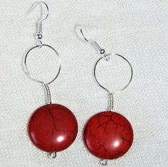 This is a pair of wire-wrapped earrings featuring pretty red circle beads!