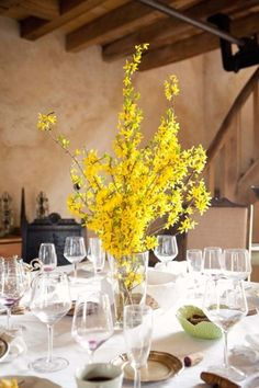 Forsythia centerpiece - France Wedding at Le Moulin Brégeon from Poppies & Me