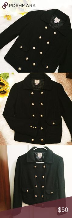 Black Pea Coat with Gold Buttons Great condition! Super warm & fashionable. Forever 21, size M, fits more like a small but could fit Medium as well! Coat is a super warm black material, with shell of coat made out of wool & viscose. Coat has inner polyester material lining. Material details: Exterior/Shell: 40% wool, 60% viscose. Lining: 100% polyester. Dry clean only. Two pockets on front of Coat each w/ one gold button. Sleeves: three gold button detailing. Peacoat has 10 buttons on front…