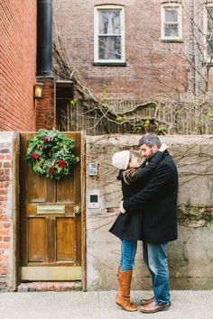NYC Christmas Engagement by B Hull Photography, wreath, doorstep, winter, scarf, beanie