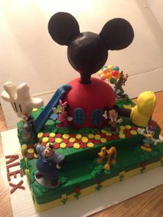 Mickey Club House Birthday Cake. Hand ,shoe is rice crispy's, Body is cake Even Disney's Big Pete is there.