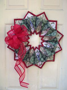 ~ Fold 'n Stitch Wreath....link to where u can buy this pattern + another link (pdf) with tips on making it