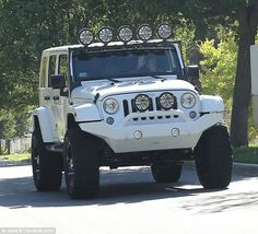 Interesting choice: Khloe drove the white Jeep given to her my French for her 30th birthday back in June