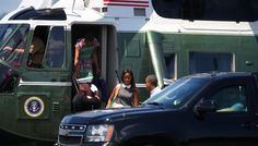 First Lady Michelle Obama exits Marine One as First daughter Malia and her father President Barack Obama prepare to get into a waiting SUV