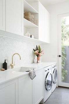 Gorgeous Laundry Room with Marble Penny Tile Backsplash, White Cabinets and Gray Tile Floors / Adore Home Magazine #roofremodel White Laundry Rooms, Modern Laundry Rooms, Laundry Room Layouts, Laundry Room Remodel, Farmhouse Laundry Room, Laundry Decor, Laundry Room Organization, Laundry Room Design, Laundry In Bathroom