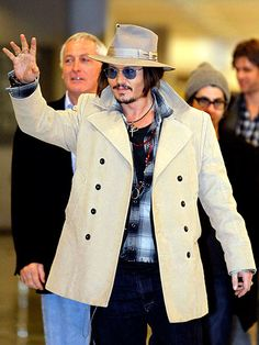 KONICHIWA, TOKYO!  Reigning Sexiest Man Alive Johnny Depp waves to fans after arriving at Narita International Airport on Tuesday. The actor is in Japan promoting Public Enemies. Credit: Kim Kyung-Hoon/Reuters/Landov  Published: Tuesday Dec 08, 2009 | 05:15 PM EST