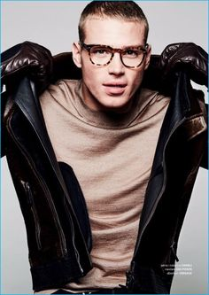 Matthew Noszka rocks a jacket and gloves by Canali with a Versace sweater and Zac Posen tortoiseshell glasses.