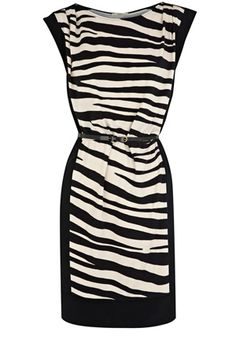 Stand out in style with this fabulous zebra print t-shirt dress. Featuring a monochrome print, scoop neckline, block colour side panels and a cinched in waist with complementing belt. This dress is suitable for the office or as a going out dress in the evening.