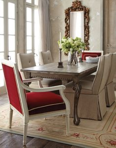 Love the pops of red in this warm, cozy dining room