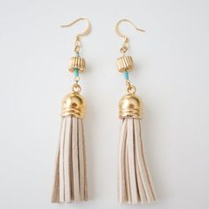 If you have 5 minutes and a handful of supplies, you can make these super easy tassel earrings!