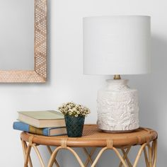 This Ceramic Table Lamp from Opalhouse™ features a global-inspired design of plants and animals, including intricate florals, butterflies and birds. The white color easily goes with your existing decor, while the embossed design adds a wonderfully artsy feel. Whether you purchase it with a bulb already included or you want to supply your own, you'll love how the textured lamp looks on your nightstand, desk, dresser or side table.<br><br>This is your house. Where you c...