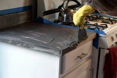 Applying the Feather Finish concrete to the laminate