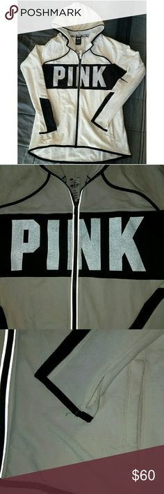 PINK White Reflective Hi-Low Full Zip Brand New. Never used. Tags still attached. PINK is reflective and so is the zipper. Sleeves have thumb holes. White-cream color. PINK Victoria's Secret Tops Sweatshirts & Hoodies