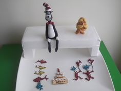 Dr.Seuss Cake toppers for a three year old little girl's birthday cake. 'The Cat in the hat', Lorax, One Fish Two Fish Red Fish Blue Fish, Thing 1 & Thing 2, and a birthday cake topper     Facebook:Cakes and Toppers by Kasy  http://www.facebook.com/pages/Cakes-and-Toppers-by-Kasy/114667928704800    Contact:kasycake@gmail.com