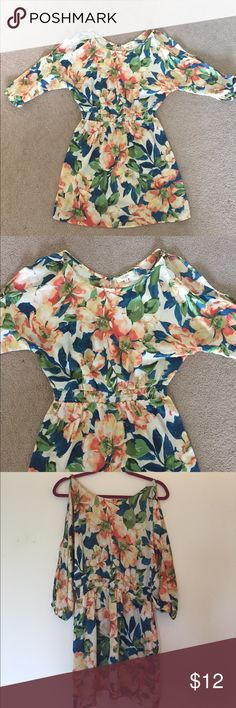 Cold Shoulder Floral Dress Bought in a local boutique worn once. Cold shoulder 4/4 length sleeves. Cinched at waist for a super flattering fit! Can be dressed up or down. Has a Silk like feel so it is a bit dressier. 60% Cotton/40% polyester. Dress is very stretchy so really could fit a bigger small-smaller Large. Umgee Dresses