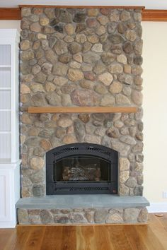 Fireplace projects with thin natural stone veneer for Fieldstone fireplace
