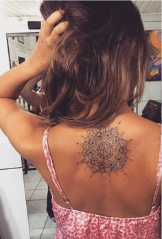 Sun mandala tattoo with Plumeria flower