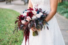 Ninfa's Wedding. Marsala and blush wedding. Burgundy and Blush. Hanging Amaranthus. Burgundy Dahlias. Mother of pearl roses. Garden Roses. Thistle. Seeded Eucalyptus. Cascade Bouquet. Bridal Bouquet. Wedding Bouquet. Outdoor wedding. Navy and Burgundy wedding. San Angel Photography. Oakleaf Florist.