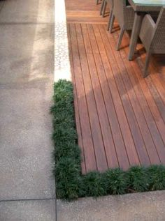 Another on grade, sunken deck. Love the border of grasses right next to the stone