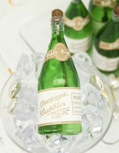 Mini Champagne Bubble Favors {Great for Weddings & Parties} - this would be a great accent for the table decor for my  small outdoor wedding. I think this is something to definitely consider. Also, something that guest can take with them ;)