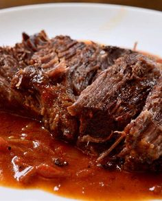 Tender pot roast coated in Cajun seasoning and served with a tomato gravy. Tender pot roast coated in Cajun seasoning and served with a tomato gravy. Creole Cooking, Cajun Cooking, Cajun Food, What's Cooking, Pot Roast Recipes, Crockpot Recipes, Cooking Recipes, Dump Recipes, Donut Recipes