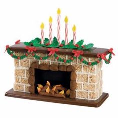 """Crisped rice cereal treats are the """"bricks"""" that build this Holly Hearth. A candy plaque forms the base. Ready-to-use fondant is rolled, shaped or cut to create the realistic details."""