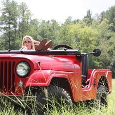 A CJ5 Jeep is seen here resting in it's regular habitat. Leave quietly so as not to scare it away :-)
