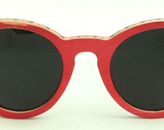 Wooden Sunglasses handmade from upcycled skateboards by Wooden Sunglasses, Skateboard, Eyewear, Upcycle, Trending Outfits, Unique Jewelry, Red, Skateboarding, Eyeglasses