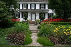 Inspiring Landscaping Ideas for Front Of House: Garden Courtyard In Beautiful Traditional Landscape Design With Black Shutters And Pea Gravel Path Also Pond With Red Flowers And Screen Door Plus Aluminum Paver Edging Also Green Trim Around The Door ~ idobrich.com Exterior Design Inspiration