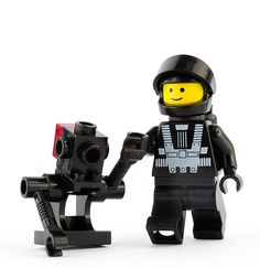 A Blacktron astronaut mini-figure and droid, from the LEGO Space sub-theme, first released in 1987