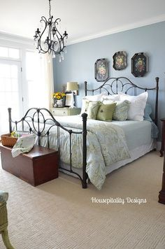 Love the touches of black in this guest room ~ black iron bed, black chandelier & the black tole painted trays above the bed paired with pale blue! Black Iron Beds, Wrought Iron Beds, French Country Bedrooms, Guest Bedrooms, Blue Bedrooms, Cottage Bedrooms, Small Bedrooms, Master Bedrooms, Master Suite