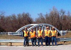 KDOT Columbus Subarea Office  employees at the rainbow bridge on the Historic Route 66 Byway. They are participating in National Work Zone Awareness Week, April 15-19, and wearing orange to show their support for highway workers across Kansas to raise awareness on the need for safety in work zones. Find out more about KDOT's work zone safety efforts at http://www.ksdot.org and click on the Go Orange logo.