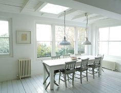 love the hanging lights and clapboard