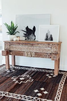 Carved wood console - Vintage rug - Black and white photography - Neutrals