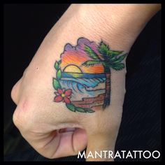 Hand paradise beach Palm tree tattoo done by Delshay At Mantra Tattoo Visit our website www.mantratattoo.us for more awesome tattoo related content!