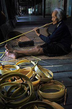 "People & NTFP in Kalimantan.A woman cleans up ""bemban"" as NTFP at her Rumah Panjang.  West Kalimantan, Indonesia, July, 2009."