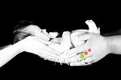 Mom & Dad holding newborn - hands only
