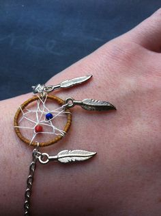 Dreamcatcher bracelet. Handmade by Courtney Cox. Matching earrings available!